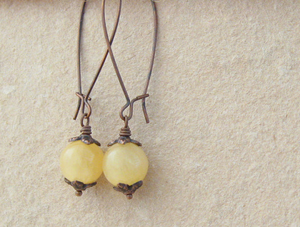 Yellow Buds earrings: semiprecious Argentinian aragonite beads with leafy, antiqued copper caps – last pair