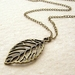 Elwood necklace: bronze skeleton leaf pendant on curb-style chain – simple and nature-inspired
