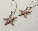 Copper Starfish earrings: lifelike, double-sided, antiqued copper starfish charms on long ear-wires