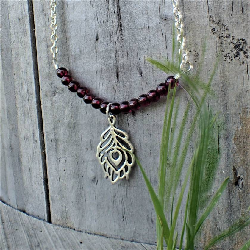Garnet Peacock Feather Necklace.