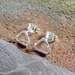 Silver Triangular Stud Earrings.
