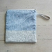 Fold over clutch bag/make-up bag in natural linen and printed cotton