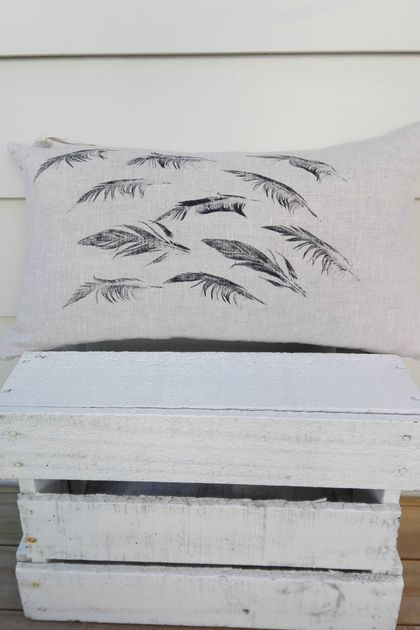 "100% linen hand printed cushion cover with ""falling feathers"" design"