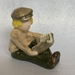 Porcelain Figurine - Boy reading a book