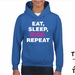 "Named ""Eat, Sleep, Ride, Repeat"" Youth Hoodie - Custom Printed Hoodie."
