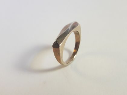 Simple bronze ring with faceted top
