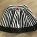 Pure Cotton Black and White striped skirt. Black and red accent