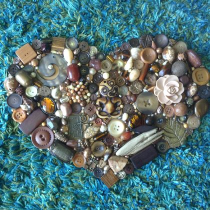 """ELEMENTS of EARTH"".... A large Heart featuring stone, shell, pearls, glass, wood, metal and more."