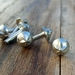 Medieval-style pewter decorative mounts - star-tipped spike design, set of six