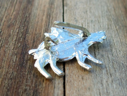 Medieval-style flying pig brooch