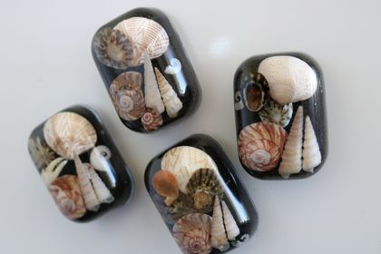 Shell and sand embedded resin magnets