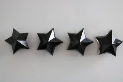Black sand star magnets -set of 4
