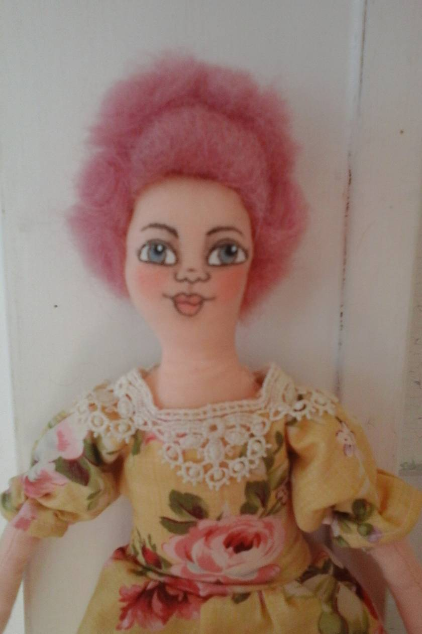 Pretty little doll dressed in yellow