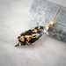 Black Tourmaline and Pure Gold Flakes in Resin Necklace