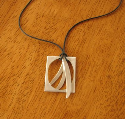 Art deco inspired design silver pendant