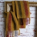 Warm wool winter unisex scarf, handwoven, in mustard with black and red strips.