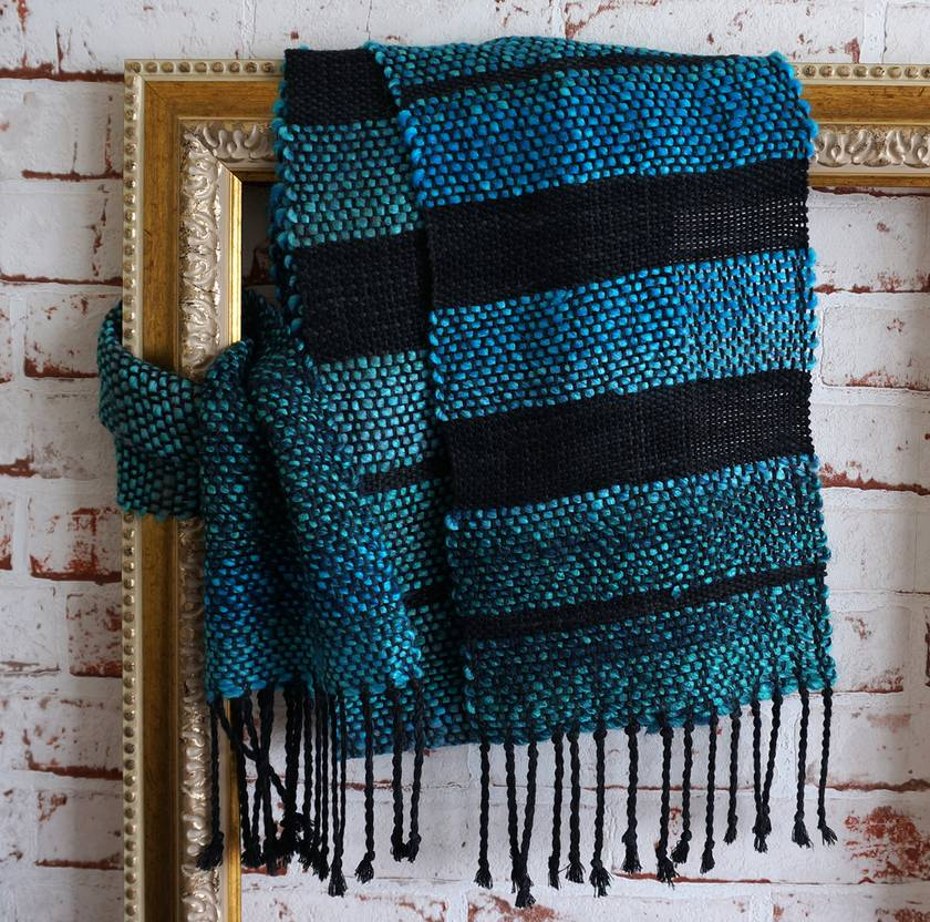 Eye-catching wool/bamboo mix, handwoven unisex scarf in teal and black.
