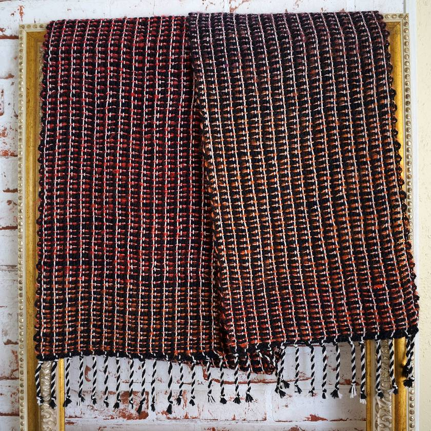 Large handwoven unisex warm winter scarf for casual or business wear in black, white and reds.
