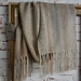 large, handwoven unisex winter scarf in soft natural stone and beige colors.