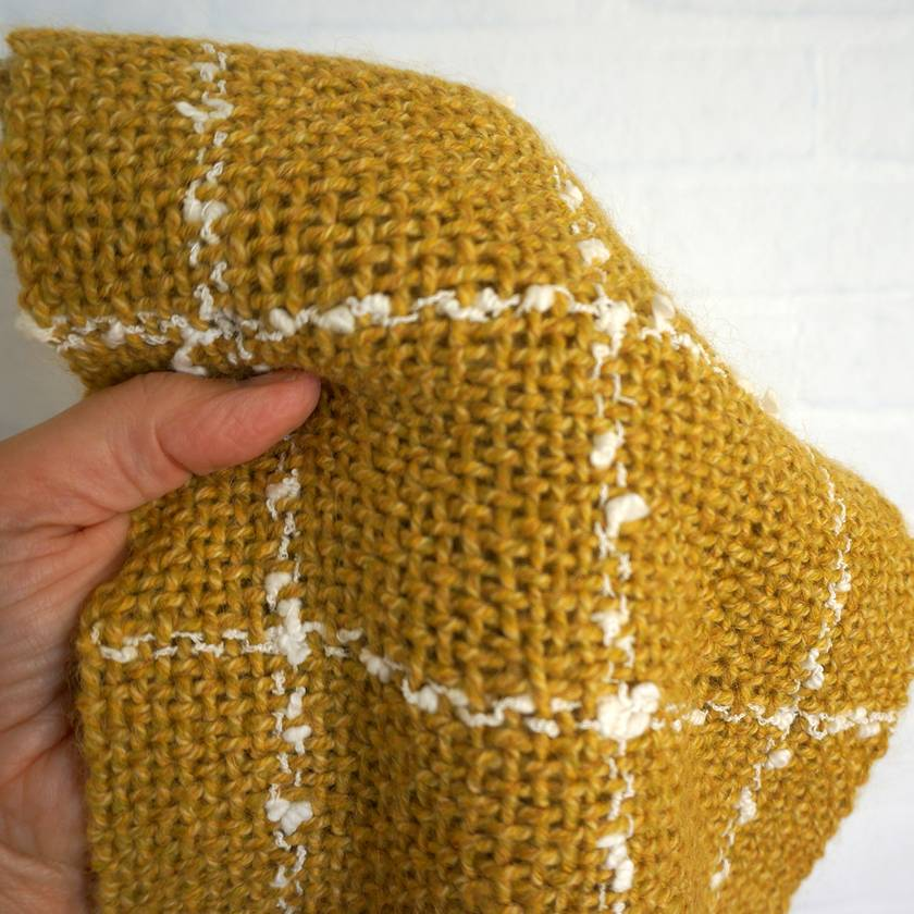 warm unisex handwoven winter scarf with plaid pattern for casual or business wear in mustard and cream.