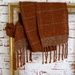 Unisex winter wool scarf, handwoven in rust wool with a check effect for casual or business wear.