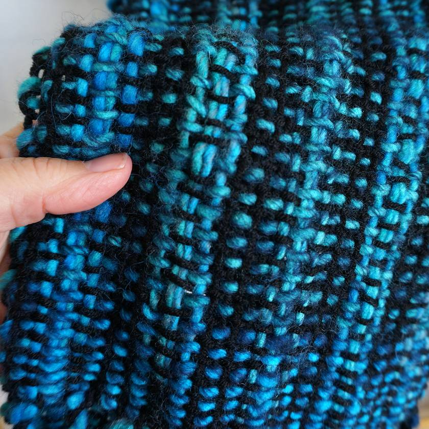 Handwoven wool  winter scarf for casual or business wear in black and teal