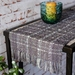 Medium Handwoven table runner in grey & whiten with contrast textured teal highlights