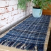 large Handwoven, textured table runner in blues, black & natural tones