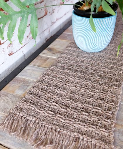 Med Handwoven, textured table runner in natural tones