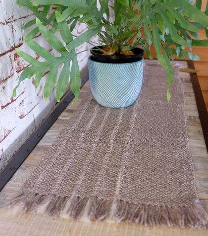 Med Handwoven, textured table runner in metallic natural tones