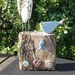 Rustic wood and ceramic bird ornament