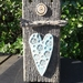 Ceramic heart on wood