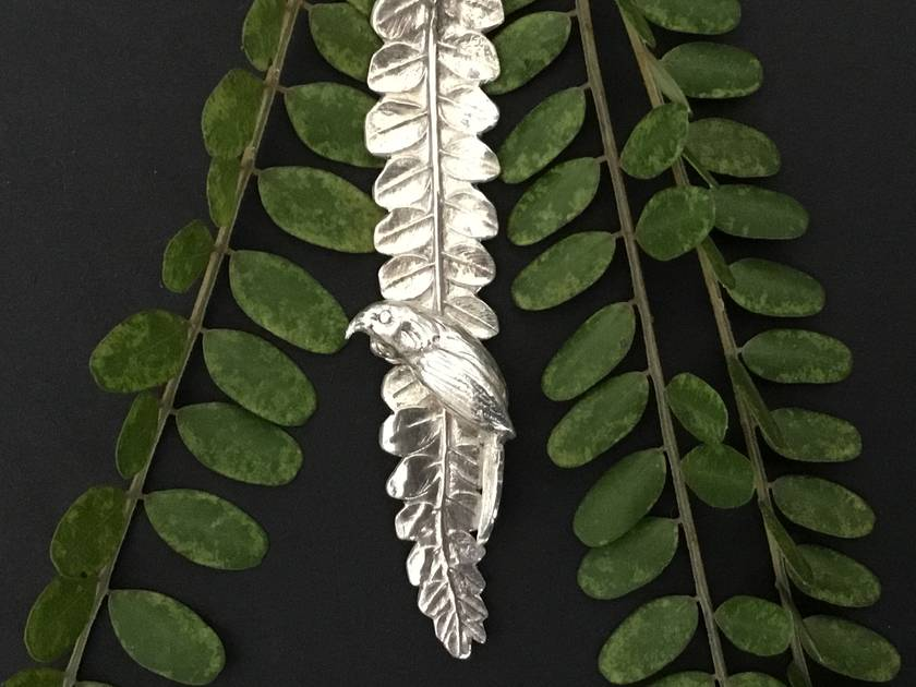 Elegant Silver Tui on Kowhai Leaf on fine sterling silver snake chain