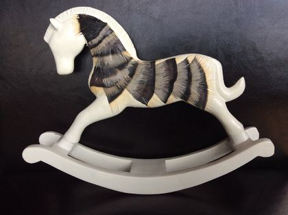 Feathered rocking horse