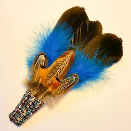 Black and turquoise feather fan