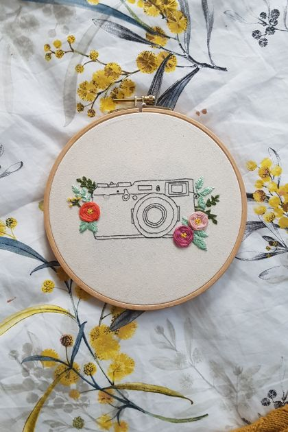 Camera hand-Embroidery with flowers
