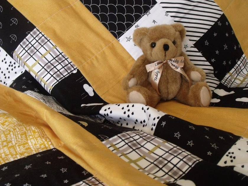 "Patchwork Quilt for Baby ""When Skies are Grey"" in gold & black"