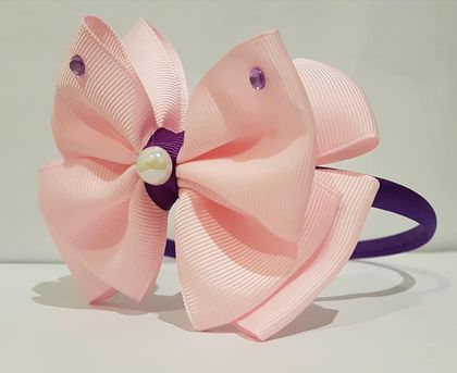 Head band with large pink bow