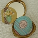 Mini-book in vintage powder compact