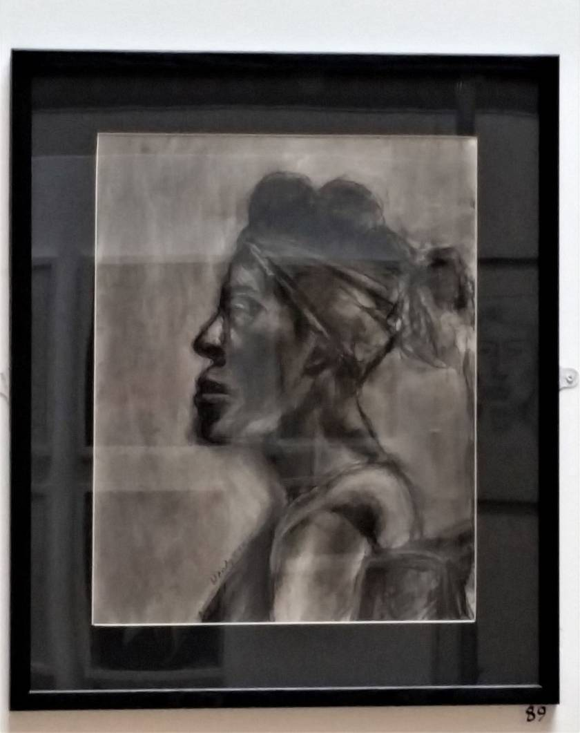 Profile of woman in charcoal