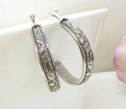 Sterling silver flower patterned hoop earrings