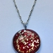 Red and gold pendant necklace