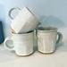 White Carved Mugs