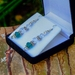 Shimmering clear glass and emerald green drop earrings | in box