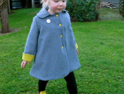 Cherry on a spotty dotti pea coat!