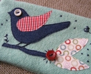 Recycled wool zippered purse in teal green with bird