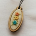 Three floral embroidered mini hoop necklace
