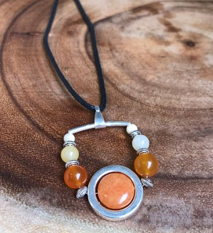 Long pendant necklace with orange gemstones and chrome plated ring