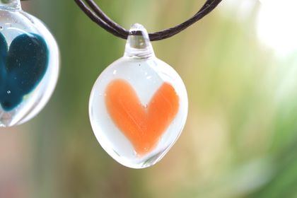 Orange Glass Heart Pendant with a Brown Cord