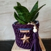 Upcycled purple plant cozie with handles